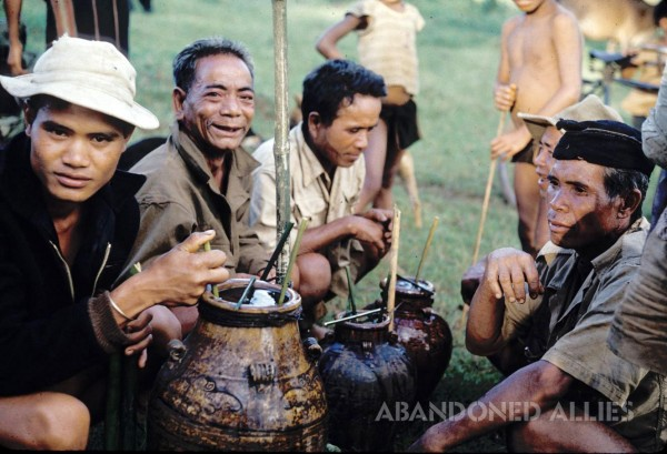 Montagnard men drink rice wine. (Courtesy of the late Rev. Charlie Long.)