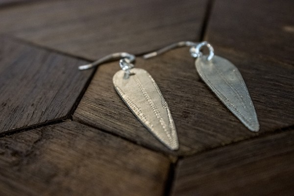 "The Flourish Market earrings - ""AK"" by Camden Watts - Photo by Caleigh Thomas"